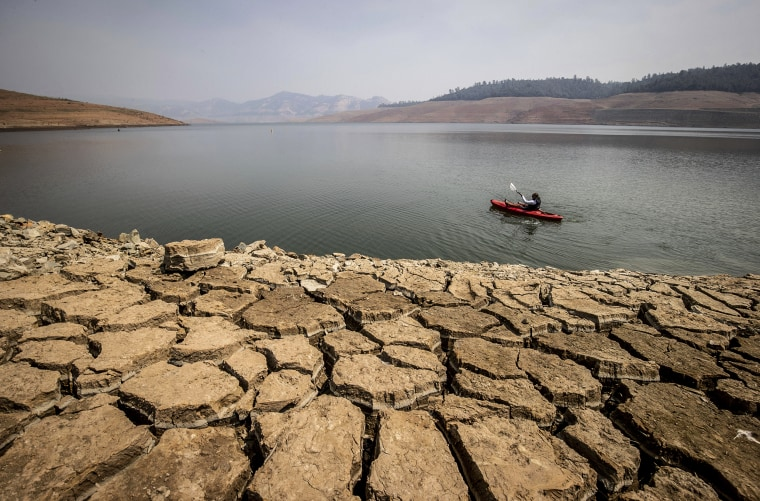 Image: A kayaker fishes in Lake Oroville as water levels remain low due to continuing drought conditions in Oroville, Calif., on Aug. 22, 2021.
