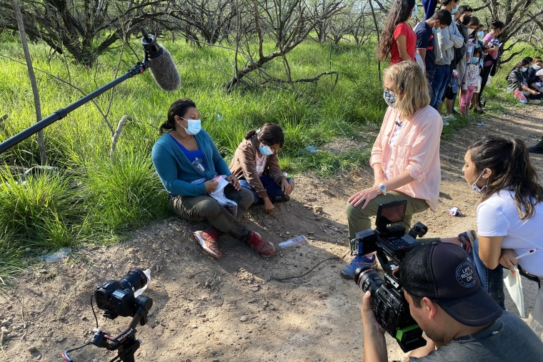 NBC News correspondent Julia Ainsley speaks with migrants at the southern border in July 2021.