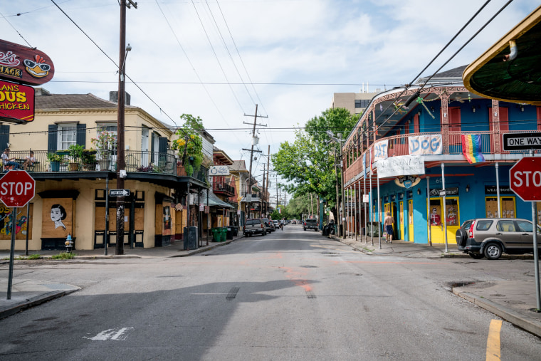 Typically packed with musicians, artists, locals and tourists visiting its many bars and music venues, Frenchman Street is seen nearly empty on the first day of Jazz Fest, April 23, 2020, in New Orleans.
