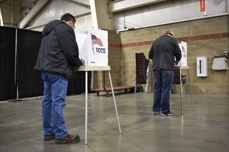 Voters fill out their ballots at the MetraPark events center in Billings, Mont., on Nov. 3, 2020.