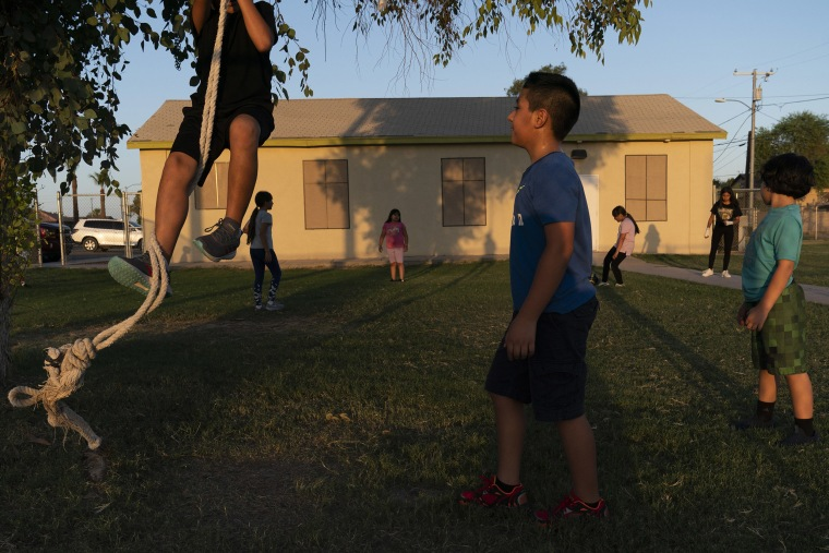 Image: Children play in the yard of a community boxing club Thursday, Aug. 19, 2021, in Somerton, Ariz.