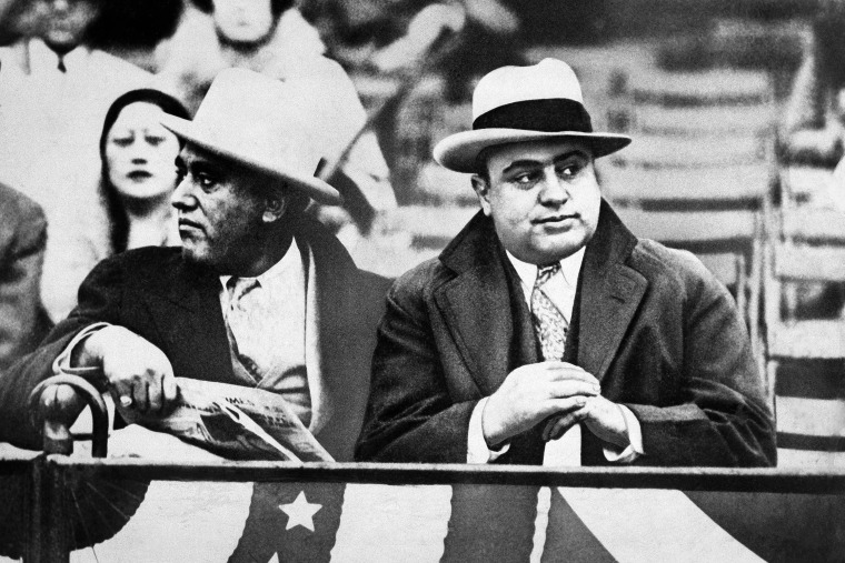 Al Capone, right, attends the Notre Dame and Northwestern Grid battle in Chicago on Oct. 10, 1931.
