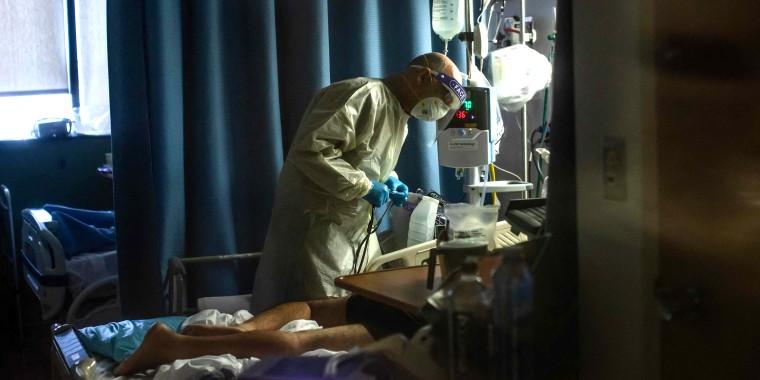 Doctor Delkhah Shahin checks on a Covid-19 patient at Providence Cedars-Sinai Tarzana Medical Center in Tarzana, California.
