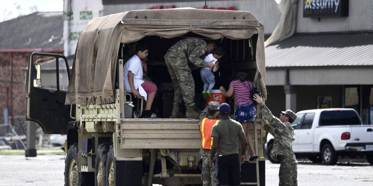 Image: A Louisiana National Guard truck assists people in Laplace, Louisiana on Monday after Hurricane Ida came ashore.