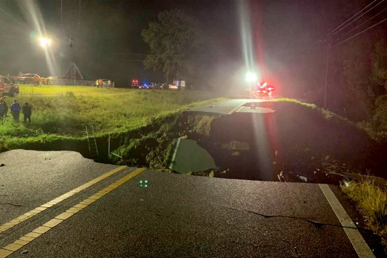 Image: Emergency crews at the scene of a road collapse in George County, Mississippi where at least two people were killed late Monday.