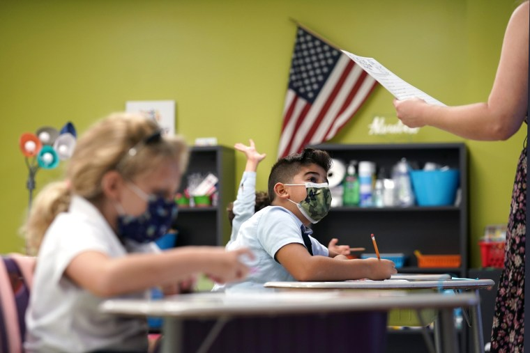 Students wearing masks pay attention on the first day of school at iPrep Academy, on Aug. 23, in Miami.