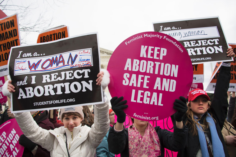 An abortion rights activist demonstrates in the middle of anti-abortion activists in front of the Supreme Court during the March For Life in Washington on Jan. 27, 2017.