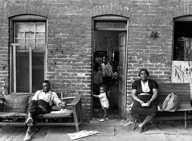 Image: A Black family at their home in Washington, D.C., in 1937.