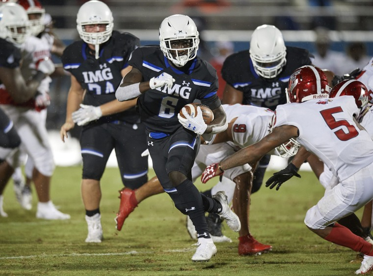 Image: IMG Ascenders running back Lovasea' Carroll (6) runs up field during a Varsity football game against the Edgewater Eagles on Sep.,17, 2020 in Bradenton, Fla.