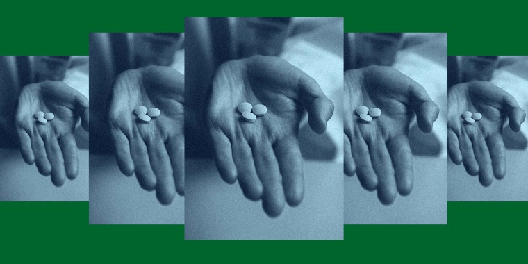 A repeating photo of a hand holding the RU-486 abortion pills.