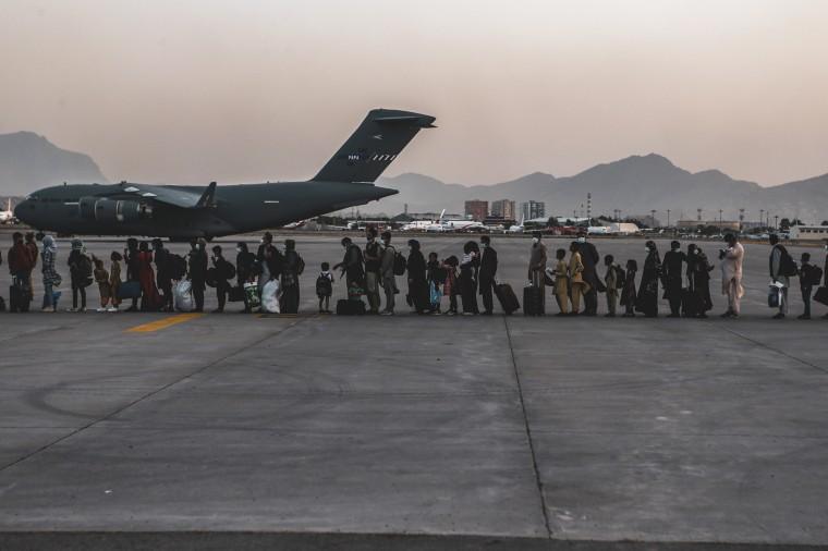 Evacuees wait to board a Boeing C-17 Globemaster III during an evacuation at Hamid Karzai International Airport, Kabul, Afghanistan, Aug. 23, 2021.