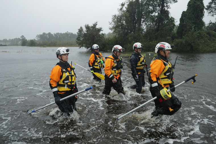 Image: Members of the FEMA Urban Search and Rescue Task Force 4 from Oakland, Calif., search a flooded neighborhood for evacuees during Hurricane Florence Sept. 14, 2018 in Fairfield Harbour, N.C.