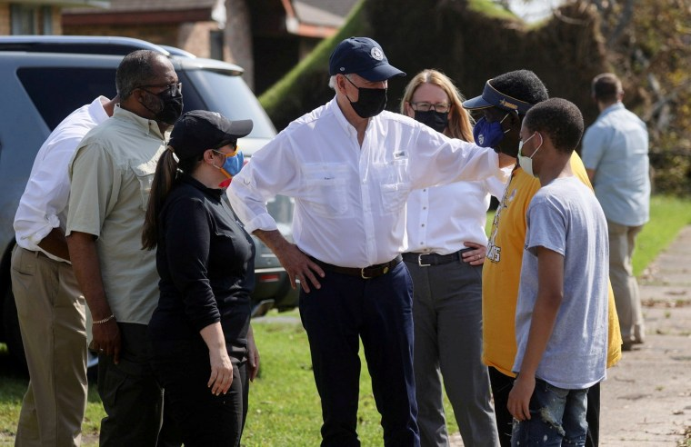 Image: Biden tours a neighbourhood hit by Hurricane Ida