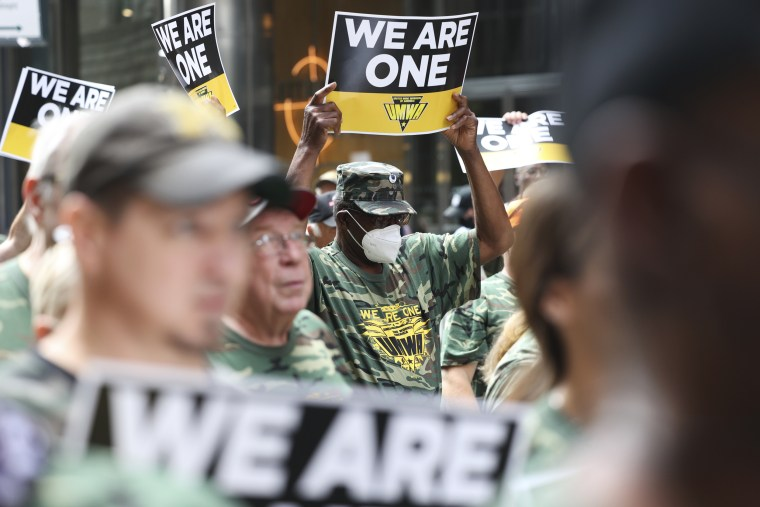 Members of the United Mine Workers of America hold signs during a strike against Alabama's Warrior Met Coal at the BlackRock offices in New York on July 28, 2021.