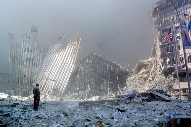 A man stands in the rubble and calls out, asking if anyone needs help, after the collapse of the first World Trade Center Tower.