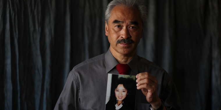 Betty Ong's brother Harry holds a portrait of her at his home in San Francisco on Sept. 6, 2011.