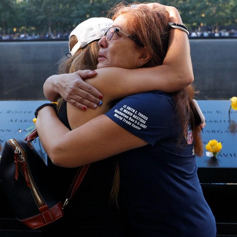 Melinda Moran and Haydee Lillo embrace at the National September 11 Memorial.