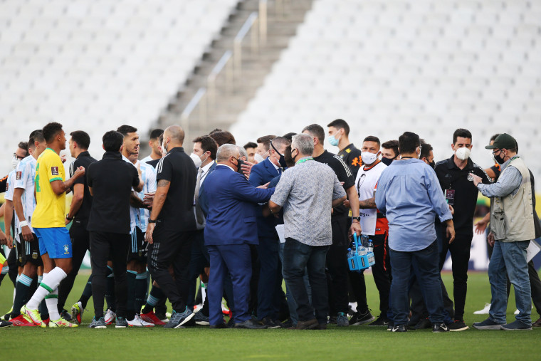 Health authorities interrupt the match as they argue with players of Brazil and Argentina during a match as part of South American Qualifiers for Qatar 2022 in Sao Paulo on Sept. 05, 2021.