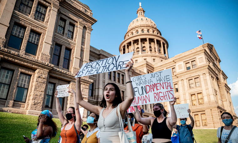 Image: Pro-choice protesters march outside the Texas State Capitol.