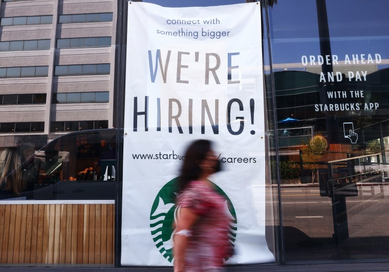 """A """"We're Hiring!"""" sign is posted on Aug. 6, 2021 in Los Angeles."""