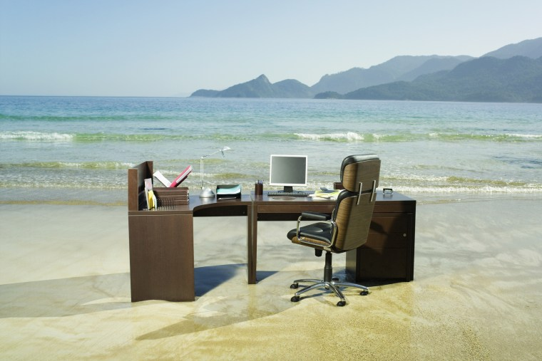Office desk on beach.