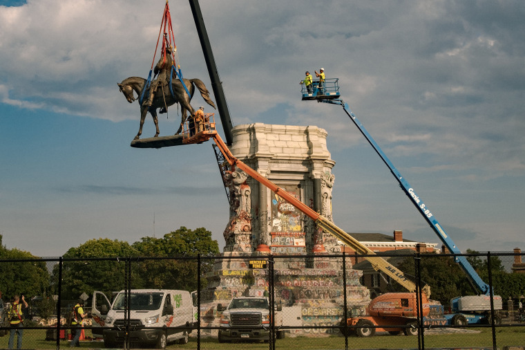 Image: The statue of Robert E. Lee is lowered from its plinth at Robert E. Lee Memorial during its removal on Sept. 8, 2021 in Richmond, Va.