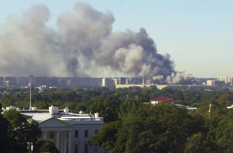 With the White House in the foreground, the Pentagon burns on Sept. 11, 2001, after an airplane crashed into the U.S. military headquarters.
