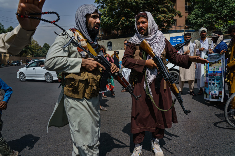 Image: Taliban fighters mobilize to control a crowd in Kabul, Afghanistan, on Aug. 19, 2021.