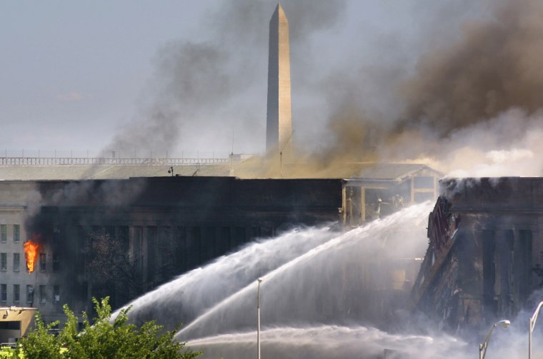 Firefighters battle flames at the Pentagon on Sept. 11, 2001.