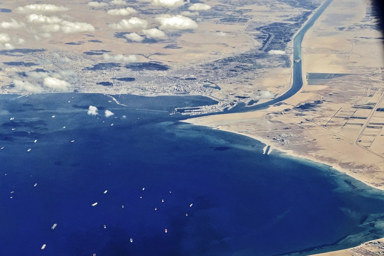 """Stranded ships waiting in queue in the Gulf of Suez to cross the Suez Canal at its southern entrance near the Red Sea port city of Suez, as the waterway remains blocked by the Panama-flagged container ship \""""MV Ever Given\"""", on March 27, 2021."""