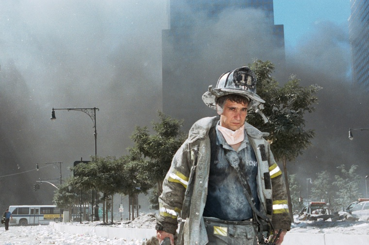 A New York City firefighter walks away from ground zero after the collapse of the World Trade Center towers on Sept. 11, 2001 in New York.