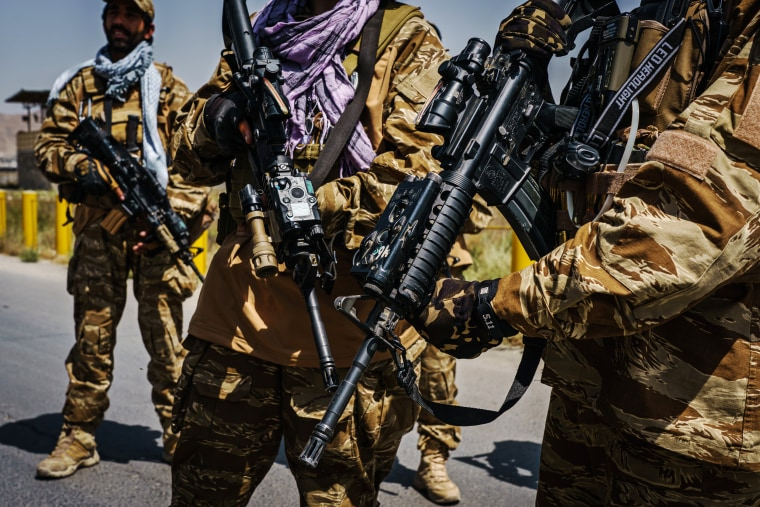 Taliban fighters armed with American weapons and equipment patrol and secure the outer perimeter alongside the American controlled side of of the Hamid Karzai International Airport in Kabul on Aug. 29, 2021.