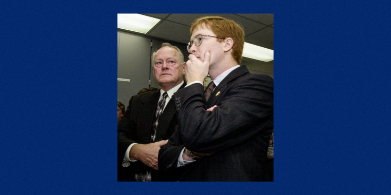 Rep. Adam Putnam, right, R-Bartow, Fla., and Sarasota County Sheriff's Advisor Larry Berberich look at television reports of the terrorist acts upon the World Trade Center while waiting for President Bush, on Sept. 11, 2001 in Sarasota, Fla.