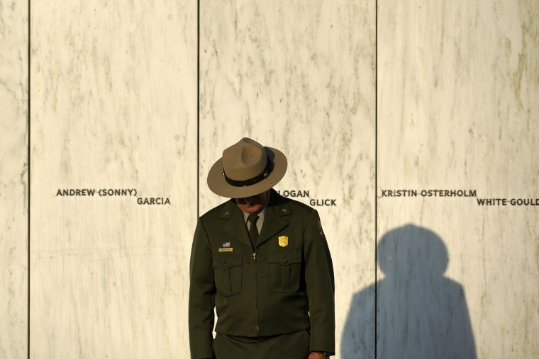 A National Park Service ranger stands in front of the Wall of Names at the Flight 93 National Memorial in Shanksville, Pa.