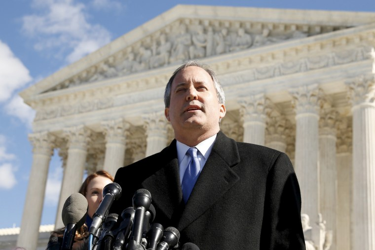 FILE PHOTO: Texas Attorney General Ken Paxton addresses reporters on the steps of the U.S. Supreme Court in Washington