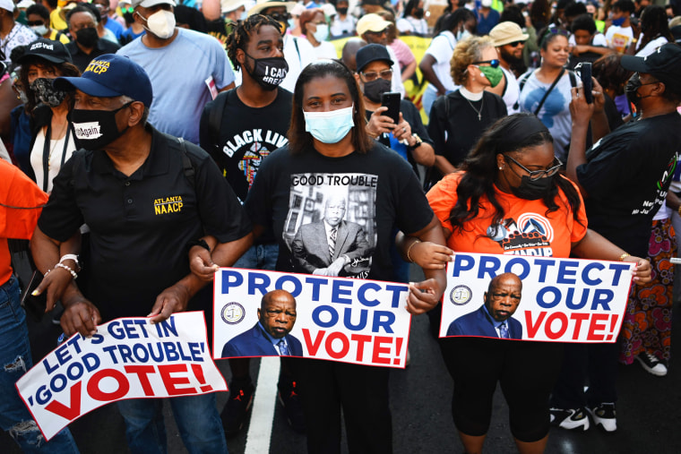 Protesters rally to demand protection for voting rights on the 58th anniversary of the 1963 March on Washington on Aug. 28, 2021, in Washington.