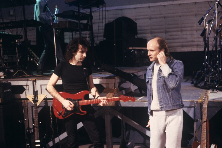 Joe Satriani, left, and his manager Mick Brigden, right, at SIR Studios in New York on Feb. 20, 1988.