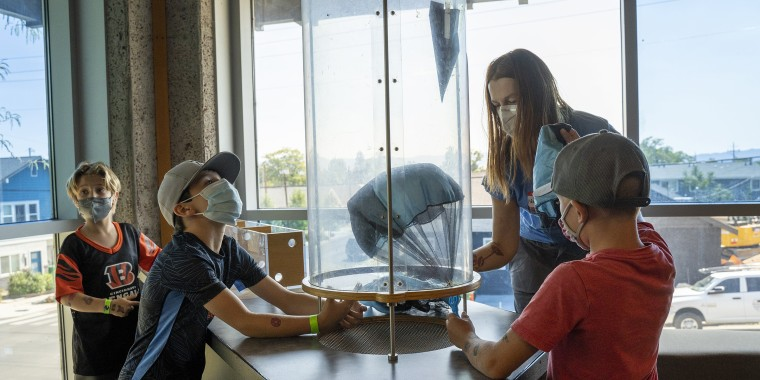 Monika Jaworska, a volunteer with Project:Camp, plays with campers at The Discovery Museum in Reno, Nevada.