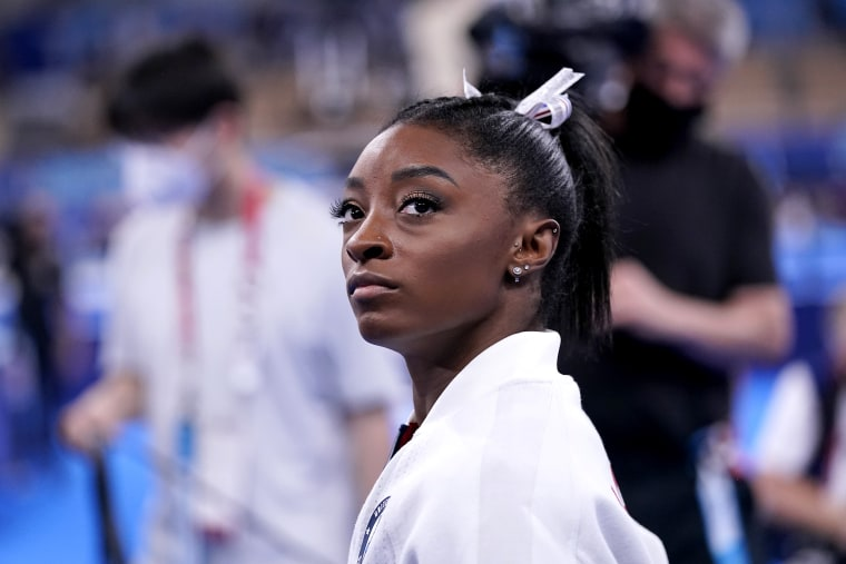 Image: Simone Biles, of the United States, waits for her turn to perform during the artistic gymnastics women's final at the Tokyo Summer Olympics on July 27, 2021.
