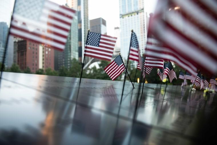 American flags adorn the South Tower reflecting pool in lower Manhattan.