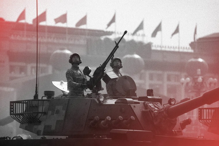 Image: Tank crew members stand at attention during a parade commemorating the 70th anniversary of Communist China in Beijing in 2019.