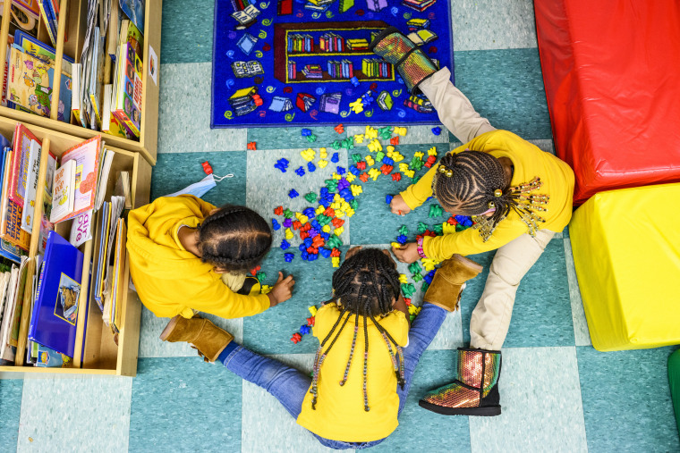 Children play together in the 3-year-old class at Little Flowers Early Childhood and Development Center located in Baltimore on Jan. 11, 2021.
