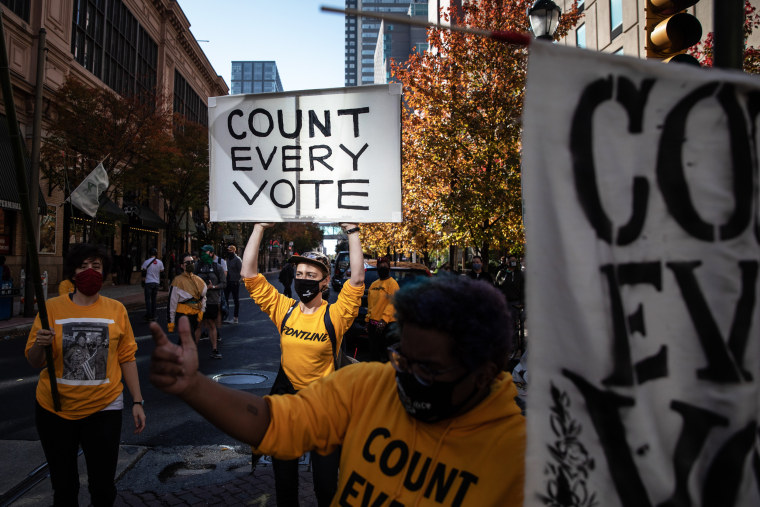 People rally in support of counting all votes as the presidential election on Nov. 5, 2020, in Philadelphia.