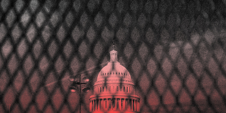 Image: The Capitol dome seen behind a security fence.