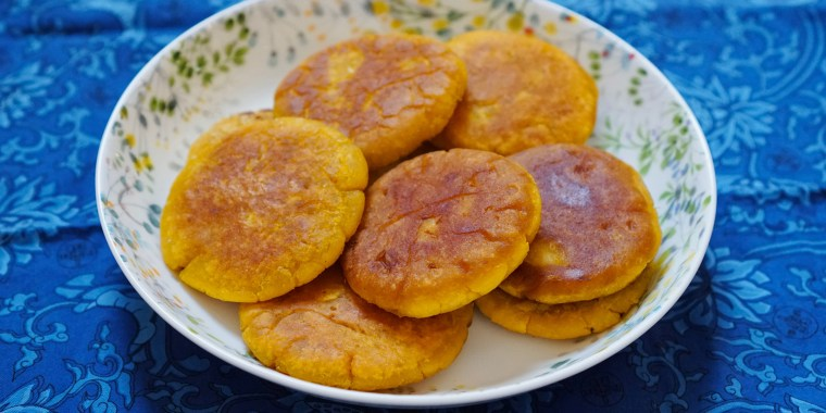 The glutinous rice flour produces a chewy, mochi-like bite, while the squash supplies creaminess and sweetness.
