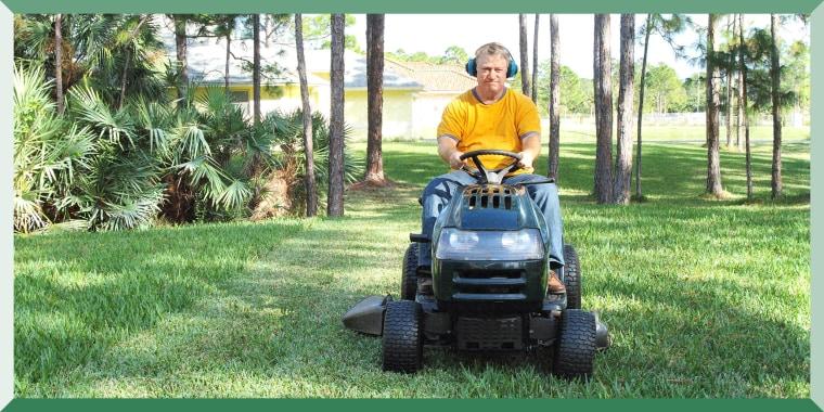 Man mowing grass on riding mower