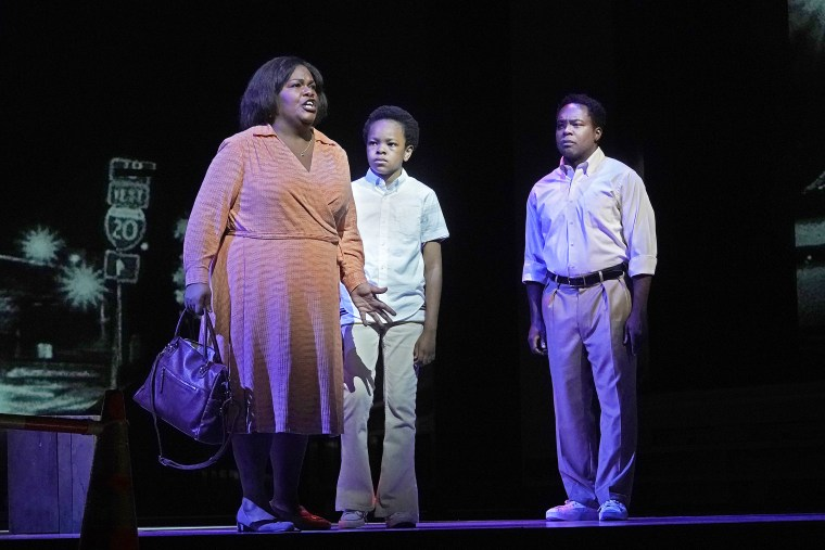 """Latonia Moore as Billie, Walter Russell III as Char'es-Baby and Will Liverman as Charles during a rehearsal for """"Fire Shut Up in My Bones"""" by Charles Blow and Terence Blanchard, which opens the Metropolitan Opera season Monday."""