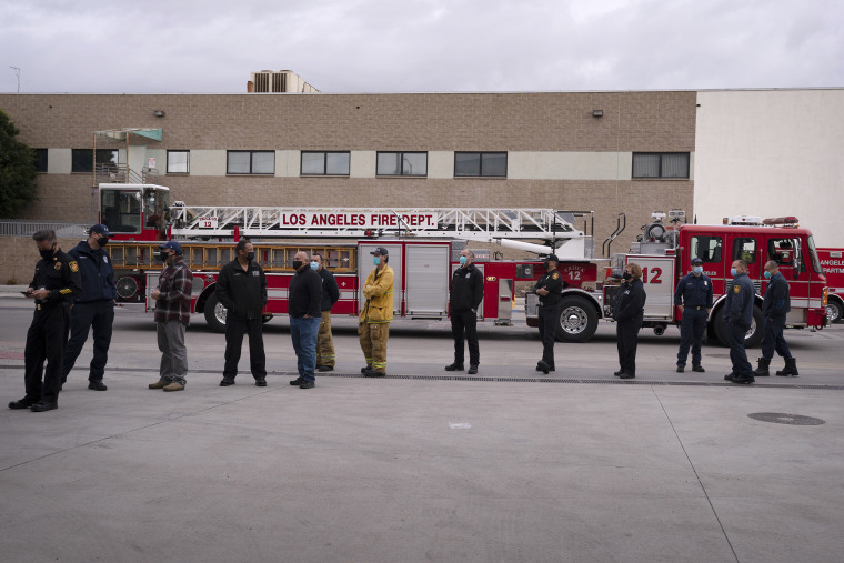 Image: Firefighters wait in line to get their Covid-19 vaccine at a fire station in Los Angeles on Jan. 27, 2021.