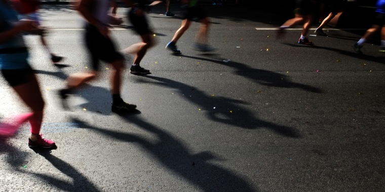 Low Section Of People Running On Street During Marathon