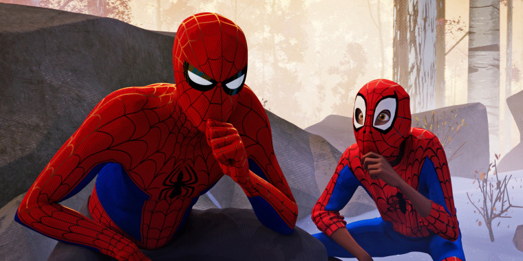 """Jake Johnson as Peter Parker, left, and Shameik Moore as Miles Morales in a scene from \""""Spider-Man: Into the Spider-Verse.\"""""""